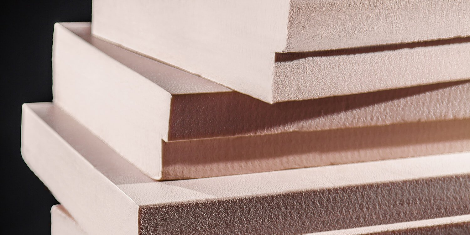 Image showing a pile of extruded polystyrene insulation panels.