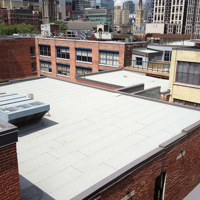 Commercial roof sealed with a flameless system